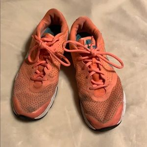 Orange and teal Nike shoes